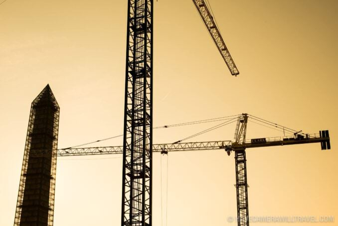 Cranes and Washington Monument Silhouette