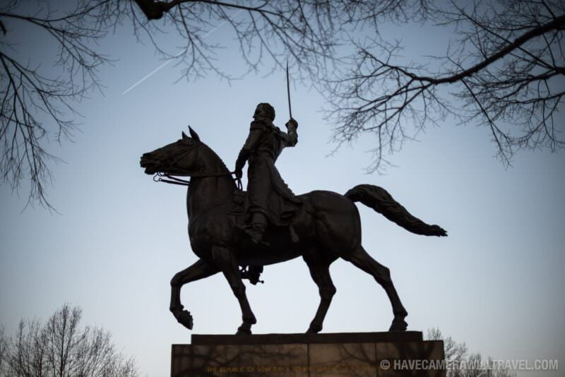 Simon Bolivar Statue Silhouette Framed by Branches