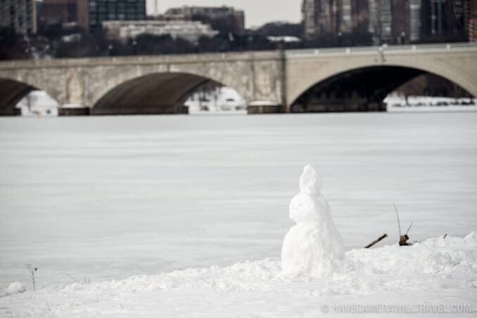 Snowman next to the Potomac with the Arlington Memorial Bridge in the Background - Potomac River Frozen Over - January 26, 2016
