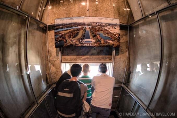Tourists Look Out from the Top of the Washington Monument