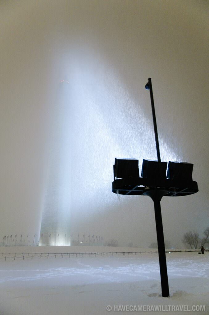 Washington Monument with floodlights in a snowstorm at night